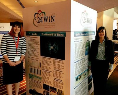 Kylie and Rebecca with their posters Abu Dhabi 2016